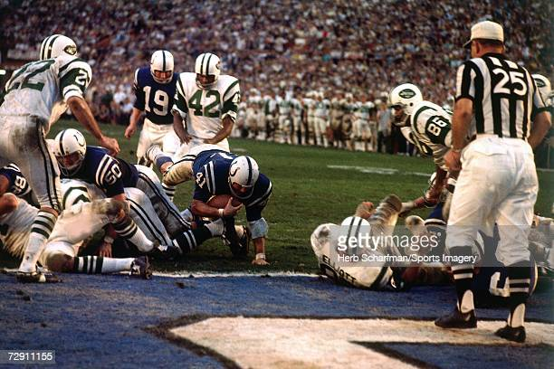 Running back Tom Matte of the Baltimore Colts dives with the ball at the endzone against the New York Jets during Super Bowl III at the Orange Bowl...