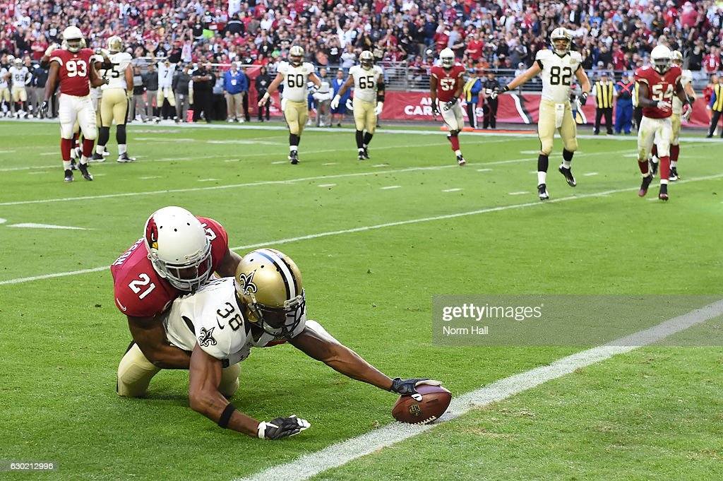 Running back Travaris Cadet #38 of the New Orleans Saints scores a ten yard touchdown reception against cornerback Patrick Peterson #21 of the Arizona Cardinals during the first quarter at University of Phoenix Stadium on December 18, 2016 in Glendale, Arizona.