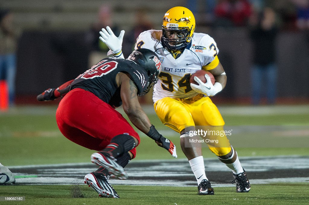 Running back Trayion Durham #34 of the Kent State Golden Flashes prepares to maneuver around Linebacker Qushaun Lee #48 of the Arkansas State Red Wolves on January 6, 2013 at Ladd-Peebles Stadium in Mobile, Alabama. Arkansas State defeated Kent State 17-13.