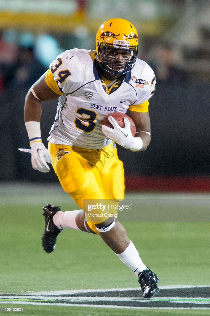 Running back Trayion Durham #34 of the Kent State Golden Flashes runs downfield while playing against the Arkansas State Red Wolves on January 6, 2013 at Ladd-Peebles Stadium in Mobile, Alabama. Arkansas State defeated Kent State 17-13.