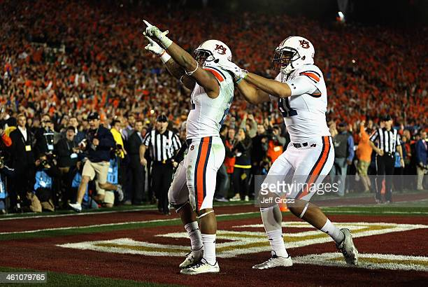 Running back Tre Mason of the Auburn Tigers celebrates after a 37yard touchdown run against the Florida State Seminoles in the fourth quarter to take...