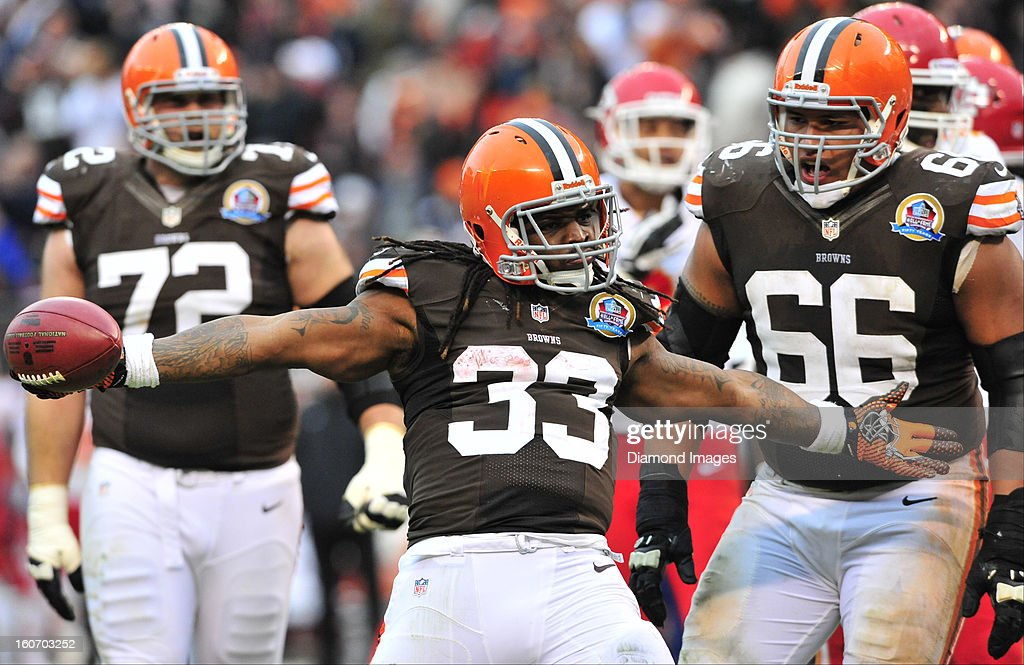 Running back Trent Richardson #33 and guard Shawn Lauvao #66 of the Cleveland Browns celebrates after scoring a touchdown during a game with the Kansas City Chiefs at Cleveland Browns Stadium in Cleveland, Ohio. The Browns won 30-7.