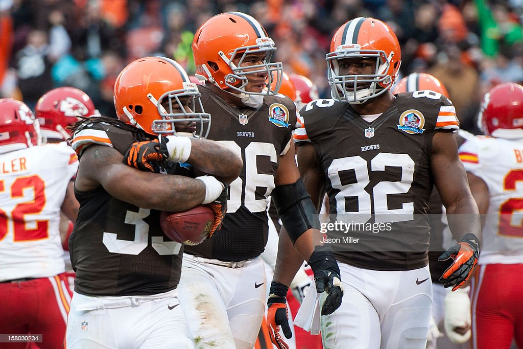 Running back Trent Richardson #33, guard Shawn Lauvao #66 and tight end Benjamin Watson #82 of the Cleveland Browns celebrate after a touchdown during the second half against the Kansas City Chiefs at Cleveland Browns Stadium on December 9, 2012 in Cleveland, Ohio. The Browns defeated the Chiefs 30-7.