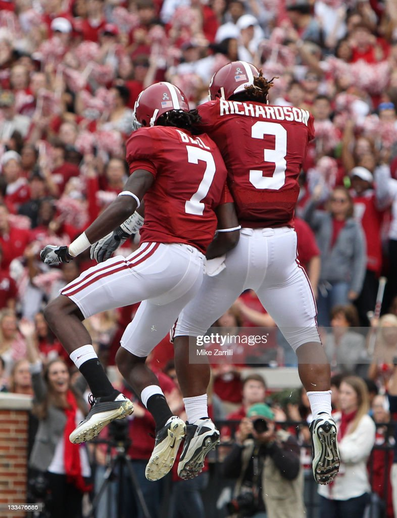 Running back <a gi-track='captionPersonalityLinkClicked' href=/galleries/search?phrase=Trent+Richardson&family=editorial&specificpeople=5653463 ng-click='$event.stopPropagation()'>Trent Richardson</a> #3 of the Alabama Crimson Tide celebrates with wide receiver and teammate Kenny Bell #7 after Richardson's first half touchdown during the game against the Georgia Southern Eagles at Bryant-Denny Stadium on November 19, 2011 in Tuscaloosa, Alabama.