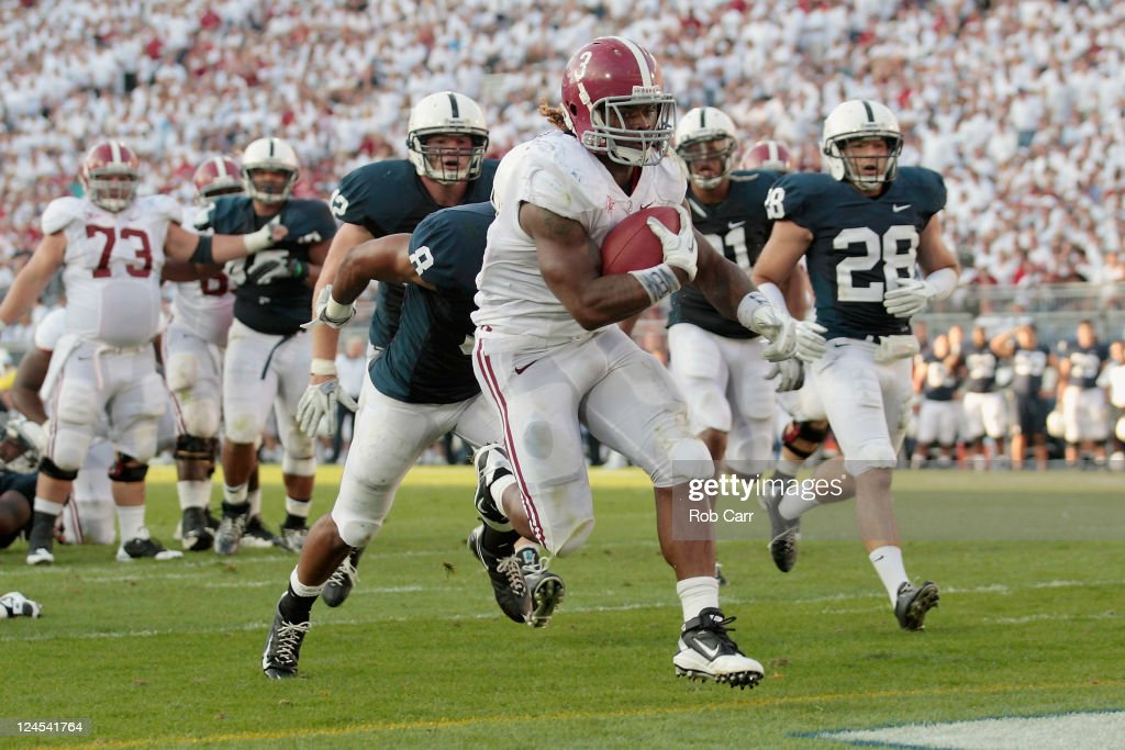 Running back Trent Richardson #3 of the Alabama Crimson Tide crosses the goal line for a touchdown against the Penn State Nittany Lions during the second half at Beaver Stadium on September 10, 2011 in State College, Pennsylvania.