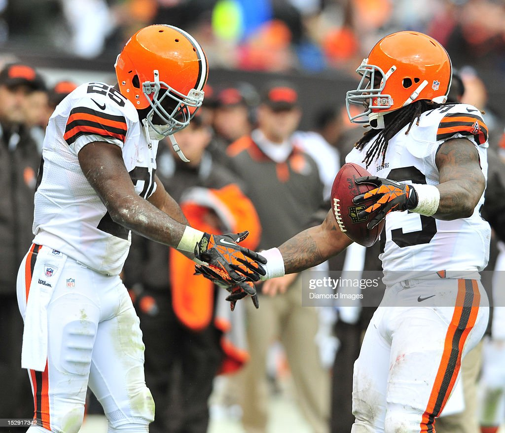 Running back Trent Richardson #33 of the Cleveland Browns celebrates after scoring a touchdown with running back Chris Ogbonnaya #25 during a game with the Buffalo Bills at Cleveland Browns Stadium in Cleveland, Ohio. The Bill won 24-14.