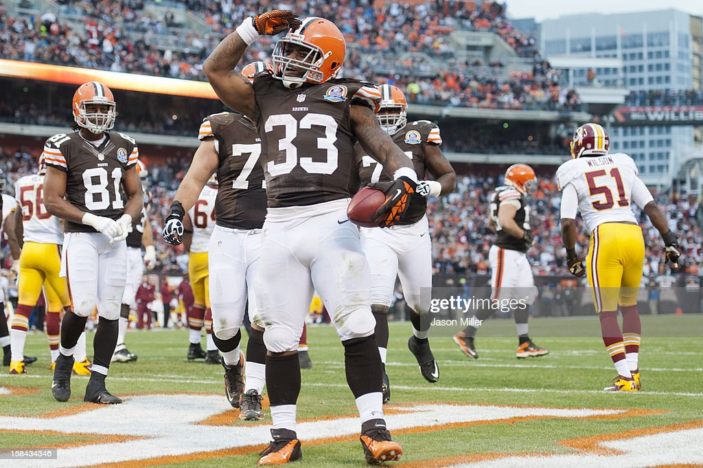 Running back <a gi-track='captionPersonalityLinkClicked' href=/galleries/search?phrase=Trent+Richardson&family=editorial&specificpeople=5653463 ng-click='$event.stopPropagation()'>Trent Richardson</a> #33 of the Cleveland Browns celebrates after scoring a touchdown during the first half against the Washington Redskins at Cleveland Browns Stadium on December 16, 2012 in Cleveland, Ohio.