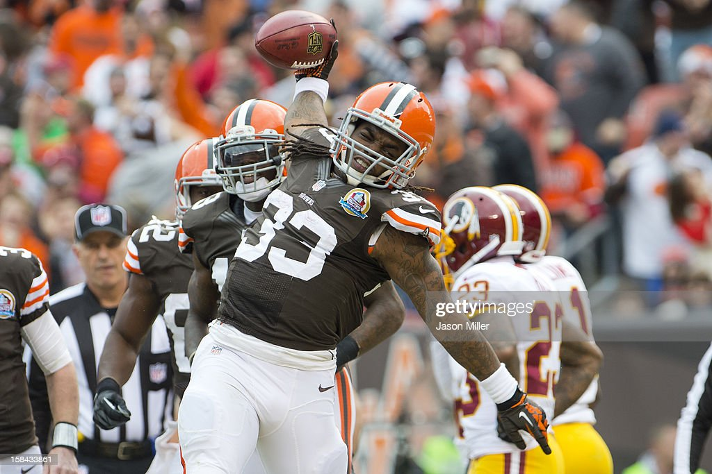Running back <a gi-track='captionPersonalityLinkClicked' href=/galleries/search?phrase=Trent+Richardson&family=editorial&specificpeople=5653463 ng-click='$event.stopPropagation()'>Trent Richardson</a> #33 of the Cleveland Browns celebrates after scoring against the Washington Redskins during the first half at Cleveland Browns Stadium on December 16, 2012 in Cleveland, Ohio.
