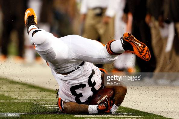 Running back Trent Richardson of the Cleveland Browns flips upside down after a play against the Baltimore Ravens during the NFL Game at MT Bank...