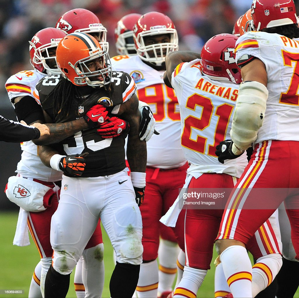 Running back Trent Richardson #33 of the Cleveland Browns is held back by defensive back Brandon Flowers #24 of the Kansas City Chiefs during a on field skirmish during a game with the Kansas City Chiefs at Cleveland Browns Stadium in Cleveland, Ohio. The Browns won 30-7.
