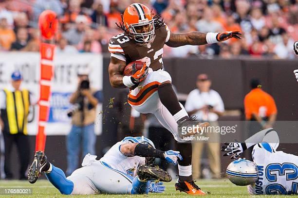 Running back Trent Richardson of the Cleveland Browns leaps over a defender during the first half of a preseason at FirstEnergy Stadium on August 15...