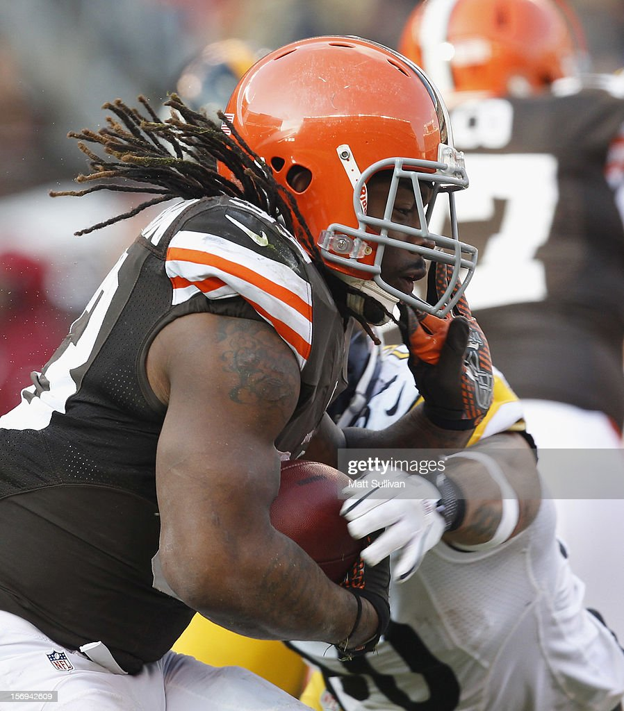 Running back <a gi-track='captionPersonalityLinkClicked' href=/galleries/search?phrase=Trent+Richardson&family=editorial&specificpeople=5653463 ng-click='$event.stopPropagation()'>Trent Richardson</a> #33 of the Cleveland Browns runs by linebacker <a gi-track='captionPersonalityLinkClicked' href=/galleries/search?phrase=Larry+Foote&family=editorial&specificpeople=213619 ng-click='$event.stopPropagation()'>Larry Foote</a> #50 of the Pittsburgh Steelers at Cleveland Browns Stadium on November 25, 2012 in Cleveland, Ohio.