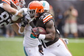 Running back Trent Richardson of the Cleveland Browns runs for a gain during the first half against the Miami Dolphins at First Energy Stadium on...