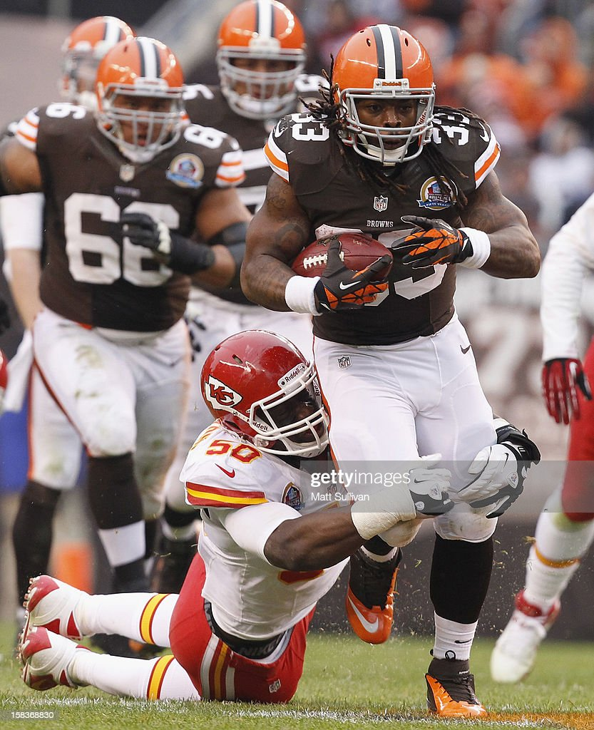 Running back Trent Richardson #33 of the Cleveland Browns runs the ball by linebacker Justin Houston #50 of the Kansas City Chiefs at Cleveland Browns Stadium on December 9, 2012 in Cleveland, Ohio.