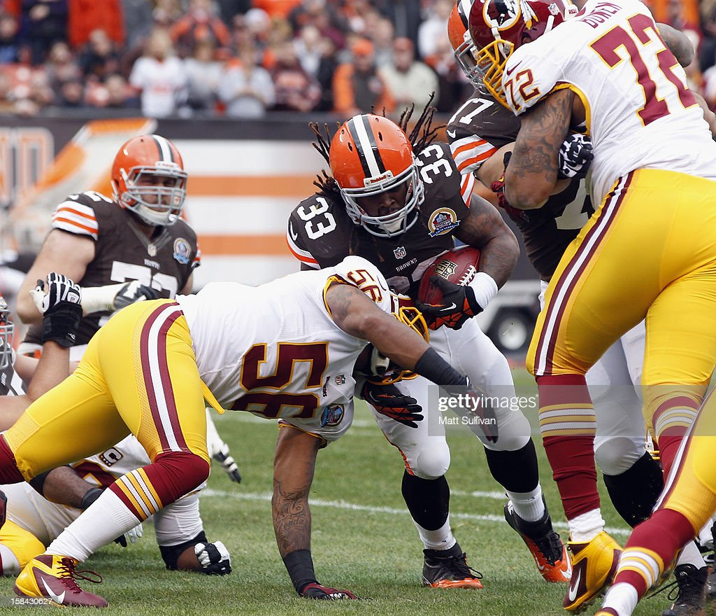 Running back Trent Richardson #33 of the Cleveland Browns scores a touchdown as he is hit by linebacker Perry Riley #56 and defensive lineman Stephen Bowen #72 of the Washington Redskins at Cleveland Browns Stadium on December 16, 2012 in Cleveland, Ohio.
