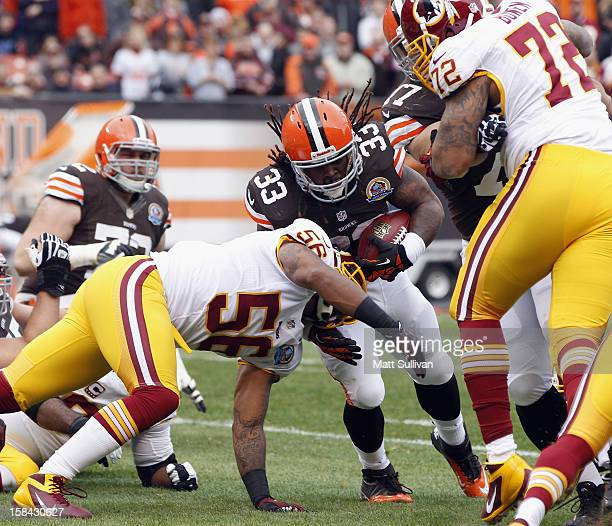 Running back Trent Richardson of the Cleveland Browns scores a touchdown as he is hit by linebacker Perry Riley and defensive lineman Stephen Bowen...