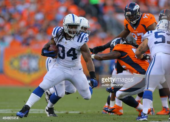Running back Trent Richardson of the Indianapolis Colts rushes against the Denver Broncos int he first quarter of a game at Sports Authority Field at...