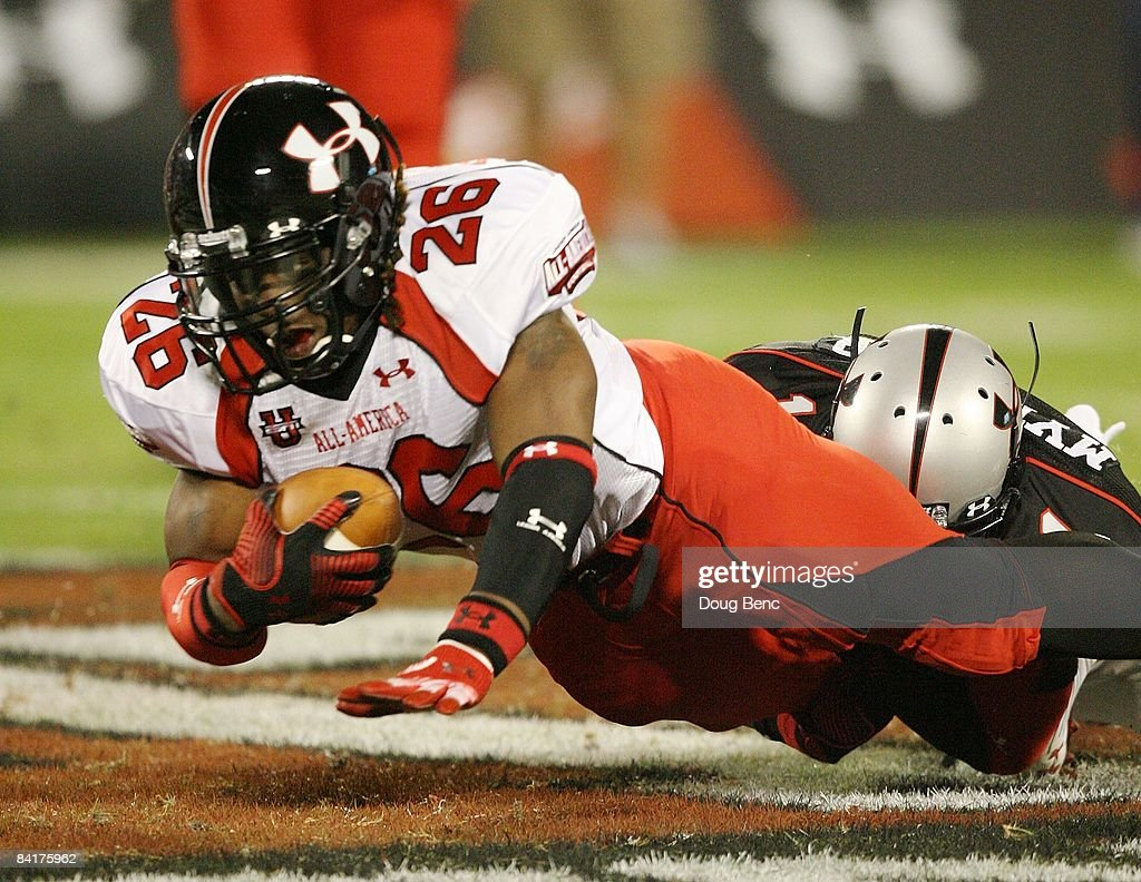 Running back Trent Richardson of the white team is brought down by safety Darren Myles Jr #1 of the black team in the All America Under Armour...