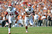Running back Trey Millard of the Oklahoma Sooners runs with the ball during the game against the Texas Longhorns on October 12 2013 at The Cotton...