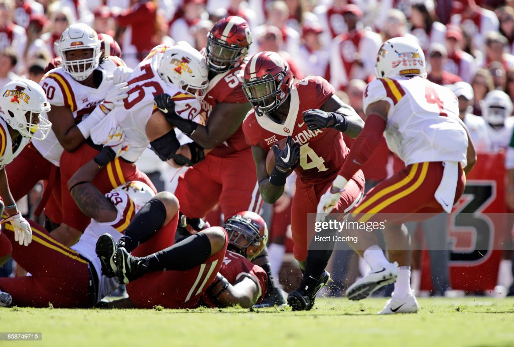 Running back Trey Sermon #4 of the Oklahoma Sooners looks for an opening against the Iowa State Cyclones at Gaylord Family Oklahoma Memorial Stadium on October 7, 2017 in Norman, Oklahoma. Iowa State defeated Oklahoma 38-31.