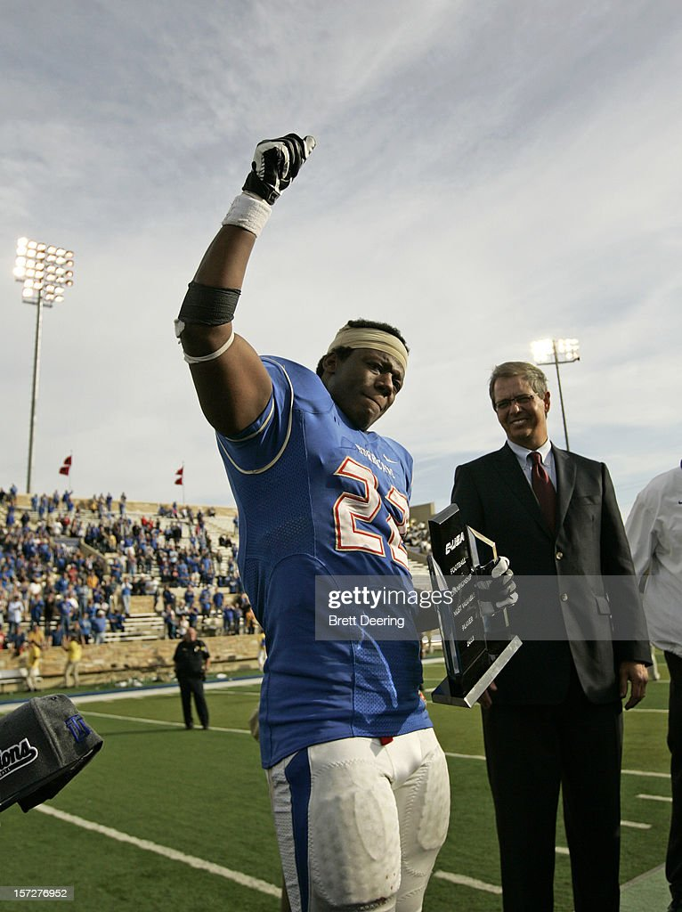 Running back Trey Watts #22 of the Tulsa Golden Hurricane holds his MVP trophy after the C-USA championship game against the Central Florida Knights on December 1, 2012 at H.A. Chapman Stadium in Tulsa, Oklahoma. Tulsa defeated Central Florida 33-27 in overtime.