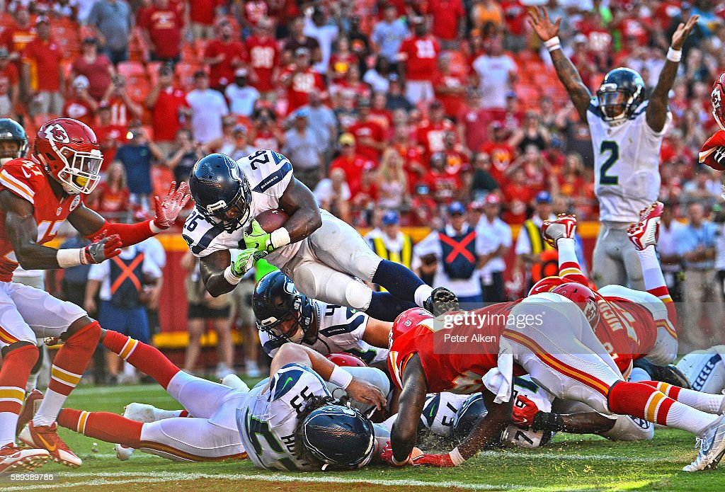 Running back Troymaine Pope #26 of the Seattle Seahawks dives over the goal line for the game winning two point conversion against the Kansas City Chiefs during the second half on August 13, 2016 at Arrowhead Stadium in Kansas City, Missouri.