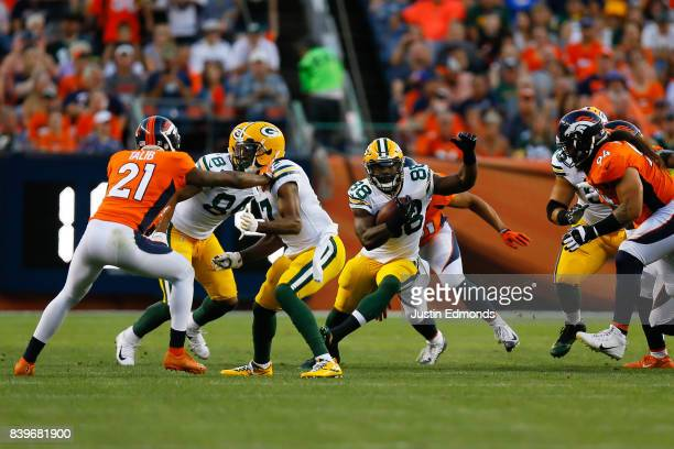 Running back Ty Montgomery of the Green Bay Packers runs with the football in the first quarter during a Preseason game against the Denver Broncos at...