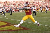 Running back Tyler Brown of the Iowa State Cyclones leaps into the end zone for a touchdown in the first half of play against the Texas Tech Raiders...