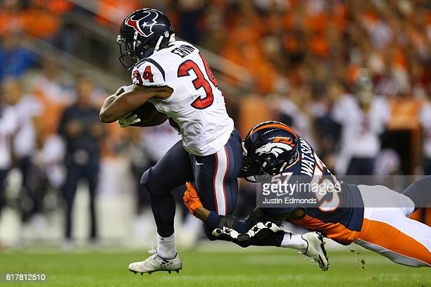 Running back Tyler Ervin of the Houston Texans catches a pass and then is tackled by linebacker Dekoda Watson of the Denver Broncos in the first...