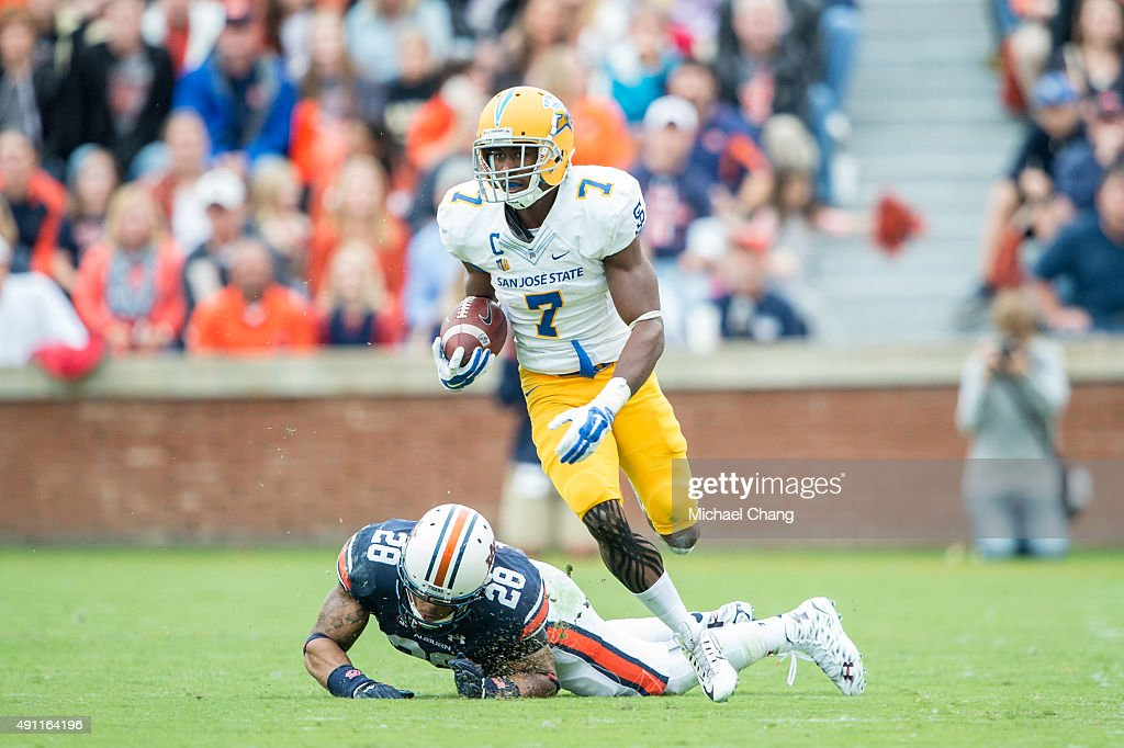 Running back Tyler Ervin of the San Jose State Spartans runs the ball past defensive back Tray Matthews of the Auburn Tigers on October 3 2015 at...