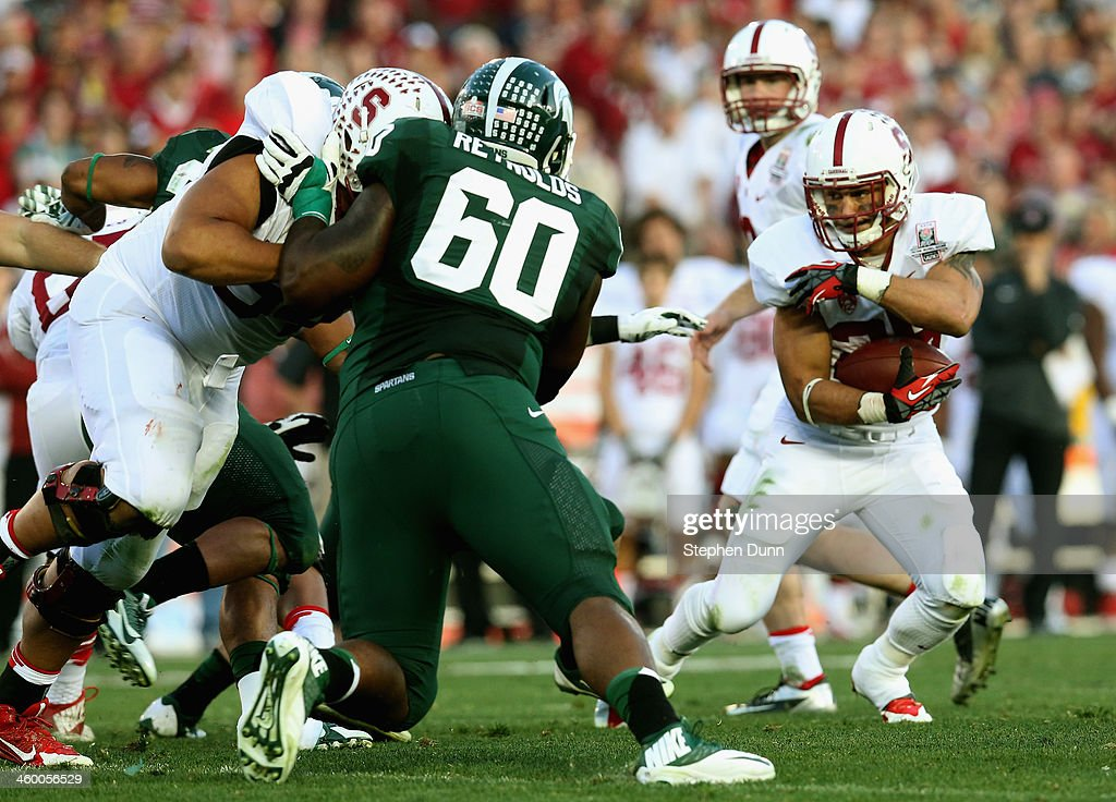 Running back <a gi-track='captionPersonalityLinkClicked' href=/galleries/search?phrase=Tyler+Gaffney&family=editorial&specificpeople=7174690 ng-click='$event.stopPropagation()'>Tyler Gaffney</a> #25 of the Stanford Cardinal runs the ball in the second half against the Michigan State Spartans during the 100th Rose Bowl Game presented by Vizio at the Rose Bowl on January 1, 2014 in Pasadena, California.