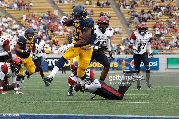 Running back Vic Enwere of the California Golden Bears scores a touchdown past defensive back Damontae Kazee of the San Diego State Aztecs during the...