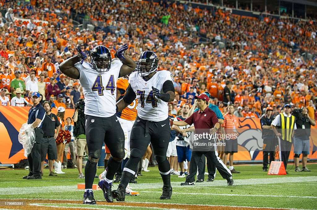 running back <a gi-track='captionPersonalityLinkClicked' href=/galleries/search?phrase=Vonta+Leach&family=editorial&specificpeople=2147886 ng-click='$event.stopPropagation()'>Vonta Leach</a> #44 and Baltimore Ravens tackle <a gi-track='captionPersonalityLinkClicked' href=/galleries/search?phrase=Michael+Oher&family=editorial&specificpeople=4077881 ng-click='$event.stopPropagation()'>Michael Oher</a> #74 celebrate a first quarter touchdown against the Denver Broncos during the game at Sports Authority Field at Mile High on September 5, 2013 in Denver Colorado.