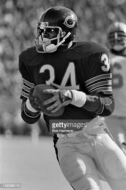 Running back Walter Payton of the Chicago Bears carries the ball against the Detroit Lions on October 19 at Soldier Field in Chigaco Illinois