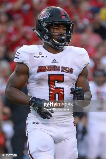 Running back Warren Wand of the Arkansas State Red Wolves enters the game against the Nebraska Cornhuskers at Memorial Stadium on September 2 2017 in...