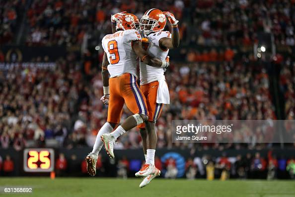 Running back Wayne Gallman of the Clemson Tigers celebrates with wide receiver Mike Williams after rushing for a 1yard touchdown during the fourth...
