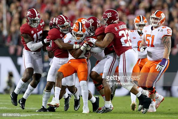 Running back Wayne Gallman of the Clemson Tigers is tackled by linebacker Tim Williams and defensive back Anthony Averett of the Alabama Crimson Tide...