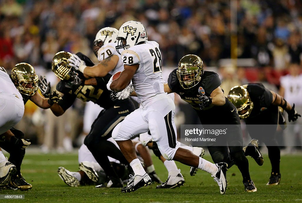 Running back William Stanback of the UCF Knights carries the ball against the Baylor Bears during the Tostitos Fiesta Bowl at University of Phoenix...