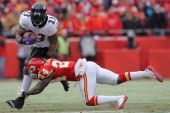 Running back Willis McGahee of the Baltimore Ravens breaks a tackle by cornerback Brandon Flowers of the Kansas City Chiefs in the first half of...