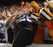 Running back Willis McGahee of the Cleveland Browns jumps into the stands after scoring a touchdown during a game against the Buffalo Bills at...