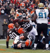 Running back Willis McGahee of the Cleveland Browns scores a touchdown in front of defensive tackle Abry Jones the Jacksonville Jaguars at...