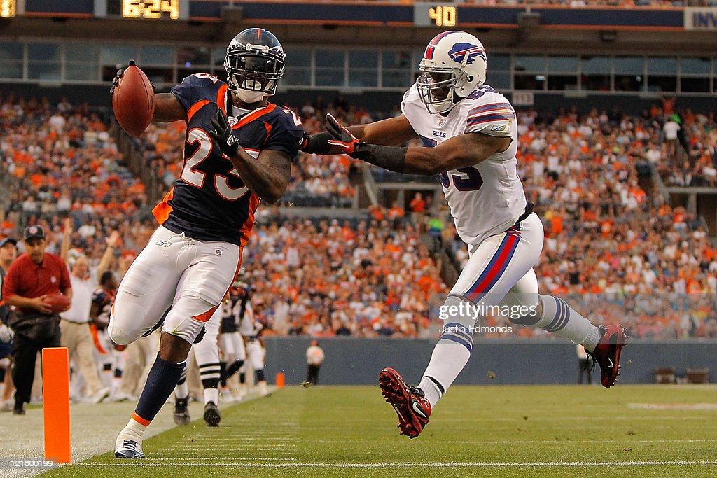 Running back <a gi-track='captionPersonalityLinkClicked' href=/galleries/search?phrase=Willis+McGahee&family=editorial&specificpeople=202895 ng-click='$event.stopPropagation()'>Willis McGahee</a> #23 of the Denver Broncos beats linebacker <a gi-track='captionPersonalityLinkClicked' href=/galleries/search?phrase=Reggie+Torbor&family=editorial&specificpeople=748812 ng-click='$event.stopPropagation()'>Reggie Torbor</a> #53 of the Buffalo Bills to the end zone for a touchdown in the second quarter at Sports Authority Field at Mile High on August 20, 2011 in Denver, Colorado.