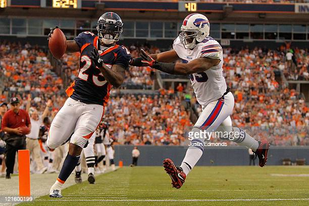 Running back Willis McGahee of the Denver Broncos beats linebacker Reggie Torbor of the Buffalo Bills to the end zone for a touchdown in the second...