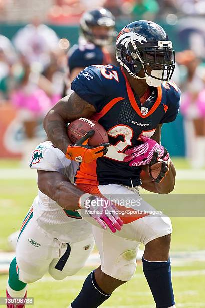 Running back Willis McGahee of the Denver Broncos carries the ball during a NFL game against the Miami Dolphins at Sun Life Stadium on October 23...