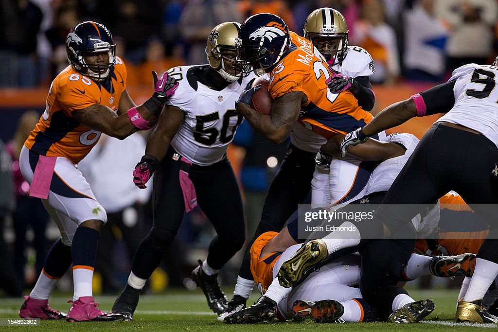 Running back Willis McGahee #23 of the Denver Broncos reaches over the goal line for a touchdown during the first quarter against the New Orleans Saints at Sports Authority Field Field at Mile High on October 28, 2012 in Denver, Colorado.