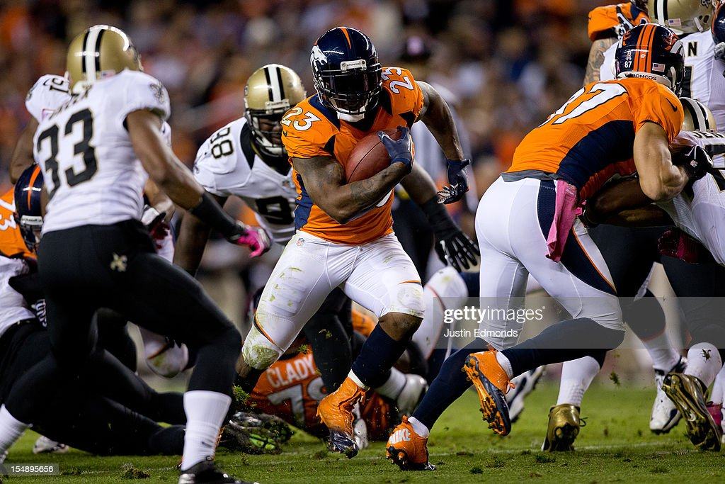 Running back Willis McGahee #23 of the Denver Broncos runs through a hole during the second quarter against the New Orleans Saints at Sports Authority Field Field at Mile High on October 28, 2012 in Denver, Colorado.