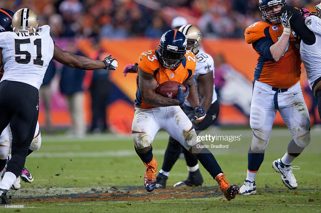 Running back Willis McGahee #23 of the Denver Broncos runs with the ball during a game against the New Orleans Saints at Sports Authority Field Field at Mile High on October 28, 2012 in Denver, Colorado.