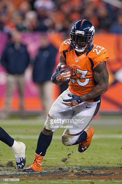 Running back Willis McGahee of the Denver Broncos rushes through a hole in the defensive line during a game against the New Orleans Saints at Sports...