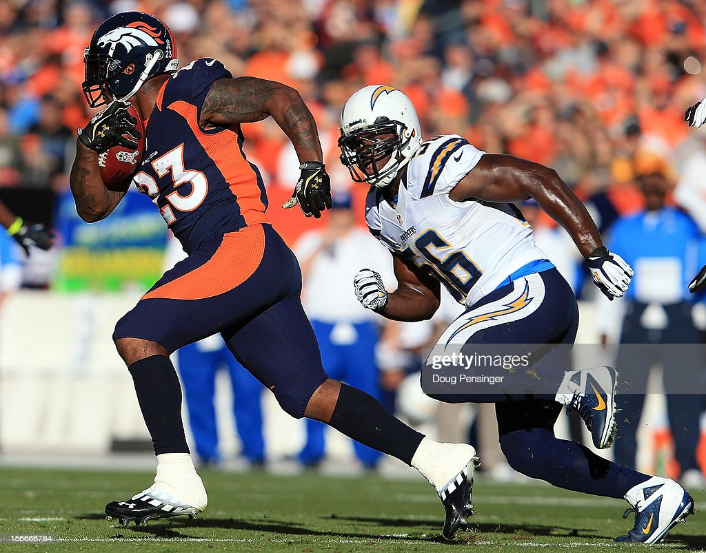 Running back Willis McGahee #23 of the Denver Broncos rushes with the ball as inside linebacker Donald Butler #56 of the San Diego Chargers pursues him at Sports Authority Field at Mile High on November 18, 2012 in Denver, Colorado. The Broncos defeated the Chargers 30-23.