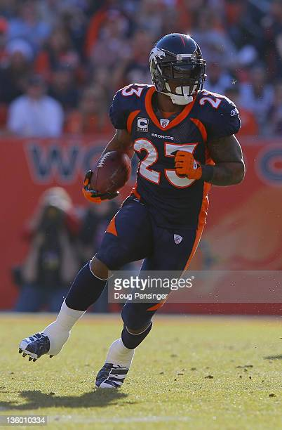 Running back Willis McGahee of the Denver Broncos rushes with the ball against the New England Patriots at Sports Authority Field at Mile High on...